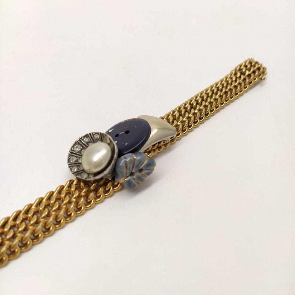 Dimensions du bracelet : largeur 1 4cm - longueur 18 5cm.